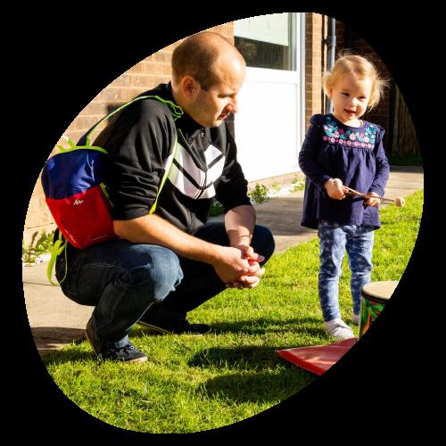parent plays with a child bubble image